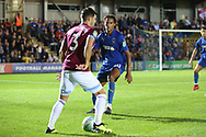AFC Wimbledon defender Toby Sibbick (20) battles for possession with West Ham United defender Aaron Cresswell (3) during the EFL Carabao Cup 2nd round match between AFC Wimbledon and West Ham United at the Cherry Red Records Stadium, Kingston, England on 28 August 2018.