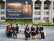 20 JANUARY 2017 - BANGKOK, THAILAND: People wait for a Buddhist religious ceremony to start on the plaza in front of Bangkok's City Hall. Hundreds of municipal workers and civil servants made merit by praying and presenting alms to 89 Buddhist monks Friday to mark 100 days of mourning since the death of revered Bhumibol Adulyadej, the Late King of Thailand. The significance of 89 monks is that the King, who died on October 13, 2016, was a few weeks short of his 89th birthday.       PHOTO BY JACK KURTZ