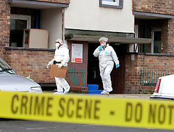 © Licensed to London News Pictures. 26/01/2012. Stockport, UK. Police and forensic officers examine the scene at a flat in Covent Gardens, Stockport after the body of a man who had been decapitated and set alight was found off nearby Wellington Street in the early hours of this (Thursday 26th) morning. Photo credit : Joel Goodman/LNP