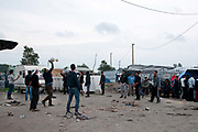 France , Calais, camp for refugees known as 'The Jungle'. September 21st 2015. Young men play volleyball.