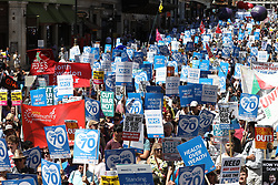 © Licensed to London News Pictures. 30/06/2018. London, UK.  Protestors march to Whitehall in support of the National Health Service on the 70th anniversary of it's founding. Thousands are taking part and will here speeches by Jeremy Corbyn and others in Whitehall. Photo credit: Peter Macdiarmid/LNP