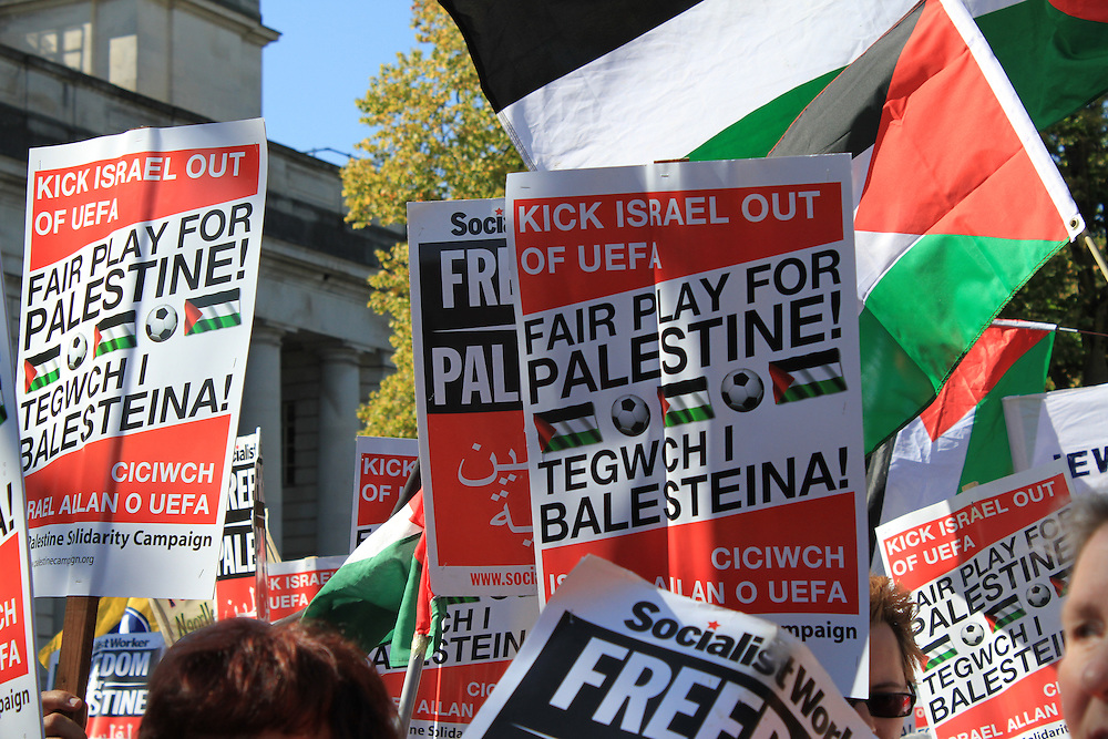 Pro-Palestinian campaigners protest against Israel's match with Wales in the UEFA Championships because of its occupation of Palestine and restrictions on freedom of movement of Palestinian footballers.