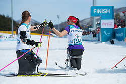 March 17, 2018 - Pyeongchang, South Korea - Joy Rondeau, right, and Oksana Masters of the US at the finish line following the 5km Cross Country event Saturday, March 17, 2018 at the Alpensia Biathlon Center at the Pyeongchang Winter Paralympic Games. Photo by Mark Reis (Credit Image: © Mark Reis via ZUMA Wire)