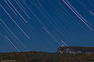 Stars streak across the sky over Skytop Tower and the Shawangunk Ridge in a composite of more than 100 exposures.