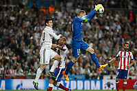 Real Madrid's James Rodriguez (L) and Atletico del Madrid´s Joao Miranda and Oblak during quarterfinal second leg Champions League soccer match at Santiago Bernabeu stadium in Madrid, Spain. April 22, 2015. (ALTERPHOTOS/Victor Blanco)