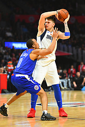 December 21, 2018 - Los Angeles, CA, U.S. - LOS ANGELES, CA - DECEMBER 20: Dallas Mavericks Guard Luka Doncic (77) is guarded closely by Los Angeles Clippers Guard Avery Bradley (11) during a NBA game between the Dallas Mavericks and the Los Angeles Clippers on December 20, 2018 at STAPLES Center in Los Angeles, CA. (Photo by Brian Rothmuller/Icon Sportswire) (Credit Image: © Brian Rothmuller/Icon SMI via ZUMA Press)