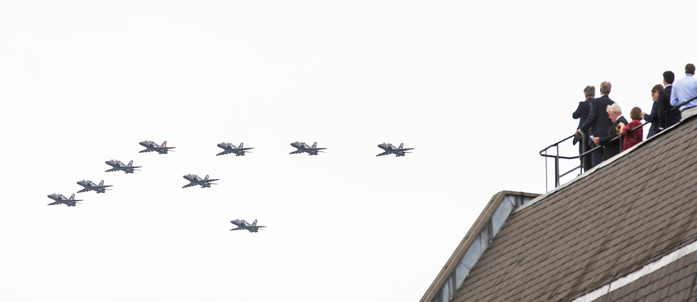 © Licensed to London News Pictures. 10/07/2018. London, UK. People watch from rooftops near Parliament Square as RAF jets fly over central London as part of the RAF100 flypast which celebrates the centenary of the Royal Air Force. Photo credit: Rob Pinney/LNP