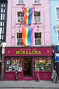 Two huge rainbow coloured Pride flags hang from the exterior of House of Minalima shop off Old Compton Street on the 5th July 2018 in London in the United Kingdom. London embraces equality ahead of Pride London Festival.