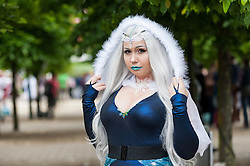 "© Licensed to London News Pictures. 29/05/2016. London, UK. A girl dresses as ""Killer Frost"", as cosplayers visit the Excel Centre on the last day of the popular MC Comic Con, a three day event celebrating games, anime, movies and more. Photo credit : Stephen Chung/LNP"
