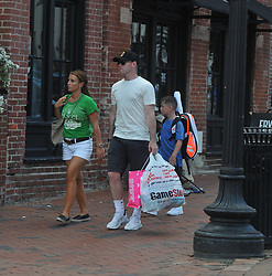 EXCLUSIVE: Wayne Rooney heads out to the bowling alley with his family in Washington, DC. He is joined by Coleen and their son, Kai who is carrying a tennis racquet bag. Wayne Rooney is carrying a bag from a video game store, Game Stop, and a bag from clothing store, Pink as they'd been in the mall earlier that day. 06 Aug 2018 Pictured: Wayne Rooney, Coleen Rooney, Kai Rooney. Photo credit: MEGA TheMegaAgency.com +1 888 505 6342