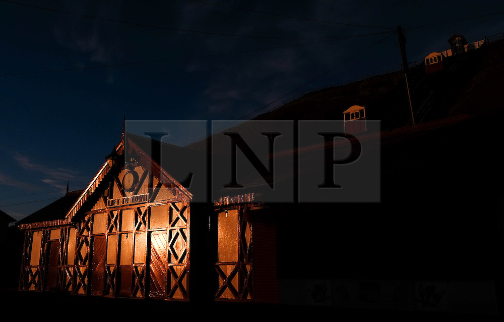 © Licensed to London News Pictures. 28/04/2016. SALTBURN BY THE SEA, UK.  <br /> Sunlight reflects from buildings on the lower promenade as the sunrises over the beach at Saltburn by the Sea.  Photo credit: Ian Forsyth/LNP