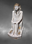 Ancient Egyptian cult statue of Amenhoptep I, limestone, New Kingdom, 19th Dynasty, (1292-1190 BC, Deir el-Medina. Egyptian Museum, Turin. Grey background.<br /> <br /> The cult of Amenhoptep I flourished during the 19th &20th Dynasties. This statue is typical of Theban sculpture of the Ramesside era : large eyes, full cheeks and aquiline nose. the kings skin colour is white rather than the more common red hue. This is typical of other Deir el-Medina statues of the era.  Drovetti collection. Cat 1372. .<br /> <br /> If you prefer to buy from our ALAMY PHOTO LIBRARY  Collection visit : https://www.alamy.com/portfolio/paul-williams-funkystock/ancient-egyptian-art-artefacts.html  . Type -   Turin   - into the LOWER SEARCH WITHIN GALLERY box. Refine search by adding background colour, subject etc<br /> <br /> Visit our ANCIENT WORLD PHOTO COLLECTIONS for more photos to download or buy as wall art prints https://funkystock.photoshelter.com/gallery-collection/Ancient-World-Art-Antiquities-Historic-Sites-Pictures-Images-of/C00006u26yqSkDOM