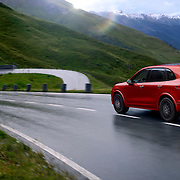 Porsche Macan driving over the Grossglockner Pass in Austria with snow capped mountains in the distance Ray Massey is an established, award winning, UK professional  photographer, shooting creative advertising and editorial images from his stunning studio in a converted church in Camden Town, London NW1. Ray Massey specialises in drinks and liquids, still life and hands, product, gymnastics, special effects (sfx) and location photography. He is particularly known for dynamic high speed action shots of pours, bubbles, splashes and explosions in beers, champagnes, sodas, cocktails and beverages of all descriptions, as well as perfumes, paint, ink, water – even ice! Ray Massey works throughout the world with advertising agencies, designers, design groups, PR companies and directly with clients. He regularly manages the entire creative process, including post-production composition, manipulation and retouching, working with his team of retouchers to produce final images ready for publication.