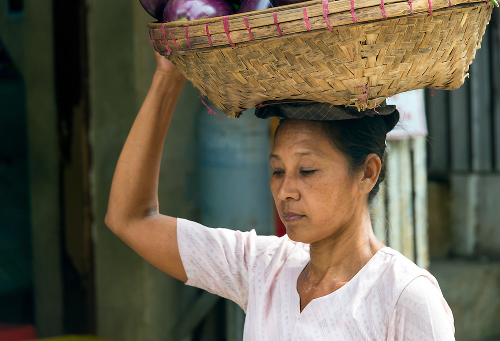 YANGON, MYANMAR - CIRCA DECEMBER 2013: Portrait of Burmese woman walking in the streets of Yangon.