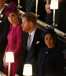The Duchess of Cambridge with the Duke and Duchess of Sussex at the wedding of Princess Eugenie to Jack Brooksbank at St George's Chapel in Windsor Castle.