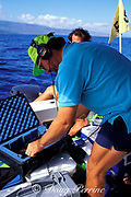 Mark Ferrari of Center for Whale Studies uses hydrophone to rercord vocalizations of humpback whales, Megaptera novaeangliae, Maui, Hawaii, ( Central Pacific Ocean )