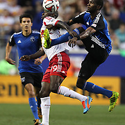 Bradley Wright-Phillips, New York Red Bulls, is challenged by Shaun Francis, (right), San Jose Earthquakes, during the New York Red Bulls Vs San Jose Earthquakes, Major League Soccer regular season match at Red Bull Arena, Harrison, New Jersey. USA. 19th July 2014. Photo Tim Clayton