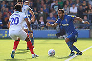 AFC Wimbledon striker Andy Barcham (17) taking on Portsmouth defender Nathan Thompson (20) during the EFL Sky Bet League 1 match between AFC Wimbledon and Portsmouth at the Cherry Red Records Stadium, Kingston, England on 13 October 2018.
