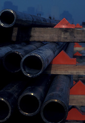 Stock photo of pipes laying on a rack at a construction site near downtown Houston Texas