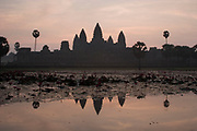 Dawn at Angkor Wat. This jewel in the crown of Angkor's ancient temples is a vision of beauty, might and Khmer architectural excellence. The five towers dominate the view, which you are led to trough outer walls, along causeways over the moat and past the two giant pools which act as a mirror of the vision. Consecrated at around 1150 to the Hindu god, Vishnu it is suggested that construction took 30 years.