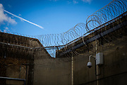 A security camera monitors the outer wall perimeter of Majesty's Prison Pentonville, London, United Kingdom. The wall is also protected with large metal fence and double layer razor wire. (Photo by Andy Aitchison)