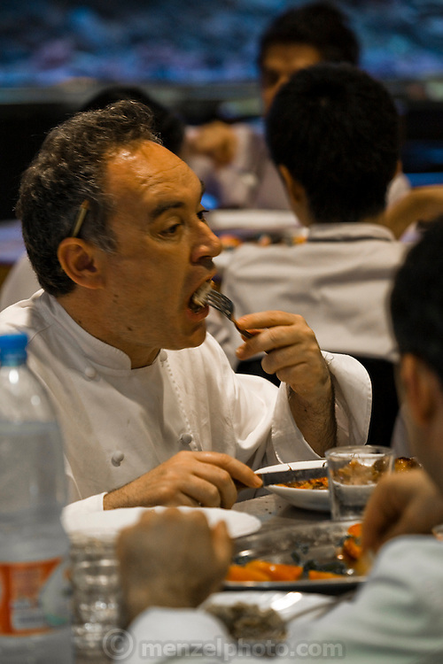 Ferran Adrià, a chef at the famous El Bulli restaurant near Rosas on the Costa Brava in Northern Spain, eats with staff in the kitchen of the restaurant.   (Ferran Adrià is featured in the book What I Eat: Around the World in 80 Diets.) MODEL RELEASED.