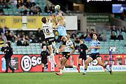 Jordie Barrett and Alex Newsome jump for the ball. Waratahs v Hurricanes. 2021 Super Rugby Trans Tasman Round 1 Match. Played at Sydney Cricket Ground on Friday 14 May 2021. Photo Clay Cross / photosport.nz