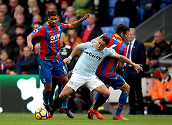 Crystal Palace's Ruben Loftus-Cheek (left) and Scott Dann (right) battle for the ball with West Ham United's Javier Hernandez (centre) during the Premier League match at Selhurst Park, London.