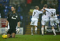 Photo: Aidan Ellis.<br /> Bolton Wanderers v Zenit St Petersburg. UEFA Cup. <br /> 03/11/2005.<br /> Bolton's first goal scorer Kevin Nolan celebrates his goal with teamamtes Stellios and Joey O' Brien