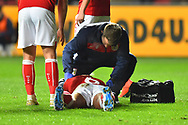 Nathan Baker (6) of Bristol City down with an injury during the The FA Cup fourth round match between Bristol City and Bolton Wanderers at Ashton Gate, Bristol, England on 25 January 2019.