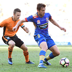 BRISBANE, AUSTRALIA - JANUARY 7: Mateo Poljak of the Jets controls the ball infant of Matt McKay of the Roar during the round 14 Hyundai A-League match between the Brisbane Roar and Newcastle Jets at Suncorp Stadium on January 7, 2017 in Brisbane, Australia. (Photo by Patrick Kearney/Brisbane Roar)