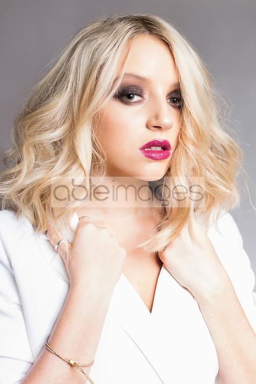 Blonde Woman wearing White Jacket