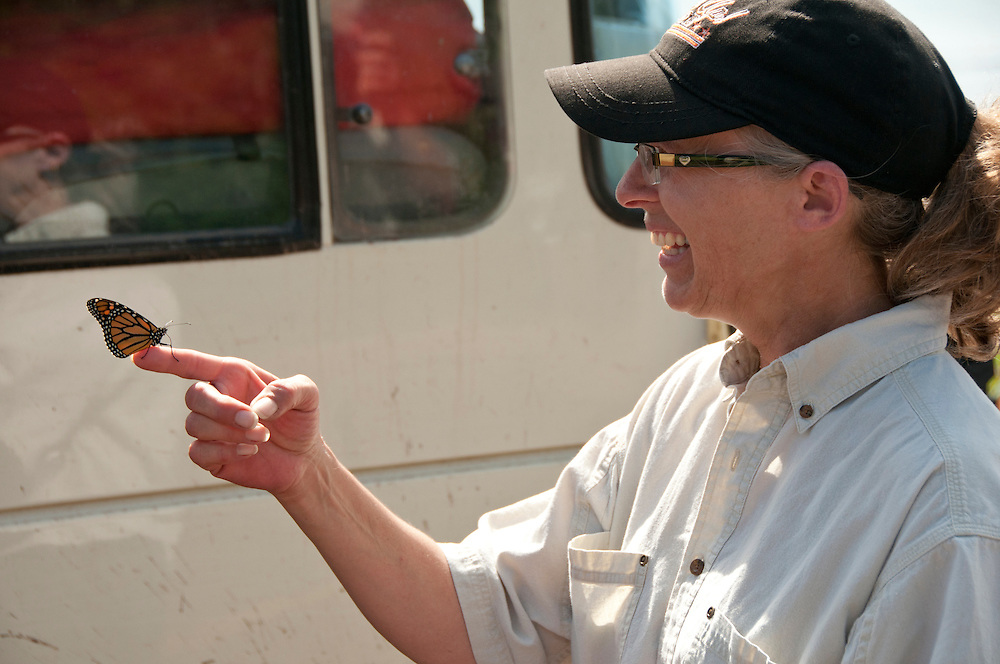 Teddi Floyd Smith of Illinois lets a monarch butterfly rest on her finger during the 2010 U.P. Overland trip in the Upper Peninsula of Michigan.