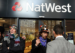 © Licensed to London News Pictures. 24/11/2011, London, UK. A business man argues with a protester. Protesters with a megaphone cause the closure of a branch of Natwest near to the camp. Occupy UK protest camp at St Paul's Cathedral today 24 November 2011. Photo credit : Stephen Simpson/LNP