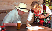 Waitress helping young visitor with directions age 25.  Zakopane Poland