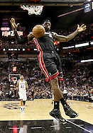 LeBron James finishes a dunk during the third quarter of Game 4 of the NBA Finals between the Miami Heat and the San Antonio Spurs at the AT&T Center on Thursday, June 13, 2013.