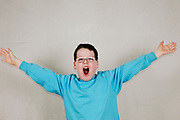 Smiling boy with arms outstretched demonstrating size