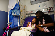 Angiel M., 13, of Mobile, Alabama with her mom, during treatment at St. Jude Children's Research Hospital
