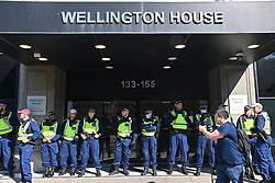 © Licensed to London News Pictures. 16/09/2021. London, UK. Police officers guard the Public Health England office entrance as anti Lockdown and anti Covid vaccination protesters take part in a demonstration calling for an end to mandatory vaccination passports and the vaccination of teenagers. Photo credit: London News Pictures