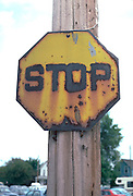 Seizure of motion machine a weathered stop sign outside of school.  Minnetonka  Minnesota USA