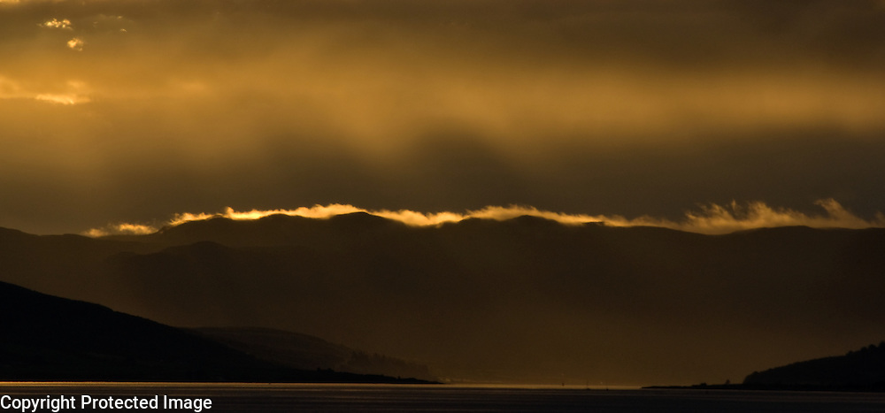 Sunset above the sea and hills, seen from Largs, Scotland, UK