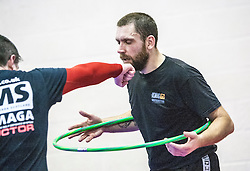 Punches and the hoop as a prop, Stef Noij, KMG Instructor from the Institute Krav Maga Netherlands, at the IKMS G Level Programme seminar today at the Scottish Martial Arts Centre, Alloa.
