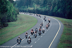 Helmet Protest, Daytona Beach, FL. 1985<br /> <br /> Limited Edition Print from an edition of 50. Photo ©1985 Michael Lichter.<br /> <br /> The Story:You feel a different kind of strength when you ride a motorcycle and when you ride in a pack, that strength becomes sheer power.  You are seen, your voice is heard and you feel invincible.<br /> <br /> After years of protest, hard work and lobbying, on July 1, 2000, the law was changed so that it was no longer mandatory for bikers to wear a helmet in Florida.