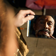 """LONDON, ENGLAND - DECEMBER 16:  Jia Zhen Gud of the Chinese State Circus get the final touches to his Emperor character at  a photocall on December 16, 2009 in London, England. The Chinese State Circus today unveiled their new acrobatic spectacular  """"Mulan""""  featuring the Shaolin Warriors .  (Photo by Marco Secchi/Getty Images)"""