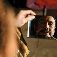 "LONDON, ENGLAND - DECEMBER 16:  Jia Zhen Gud of the Chinese State Circus get the final touches to his Emperor character at  a photocall on December 16, 2009 in London, England. The Chinese State Circus today unveiled their new acrobatic spectacular  ""Mulan""  featuring the Shaolin Warriors .  (Photo by Marco Secchi/Getty Images)"