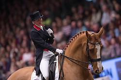Laura Tomlinson (GBR) retires Mistral Hojris (Alf) at the London International Horse Show Olympia<br /> Reem Acra FEI World Cup Dressage Kür<br /> London International Horse Show Olympia 2013<br /> © Hippo Foto - Jon Stroud