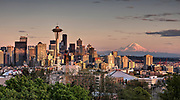 The Seattle Skyline at sunset with Mount Rainier in the background. Photo by Brandon Alms Photography