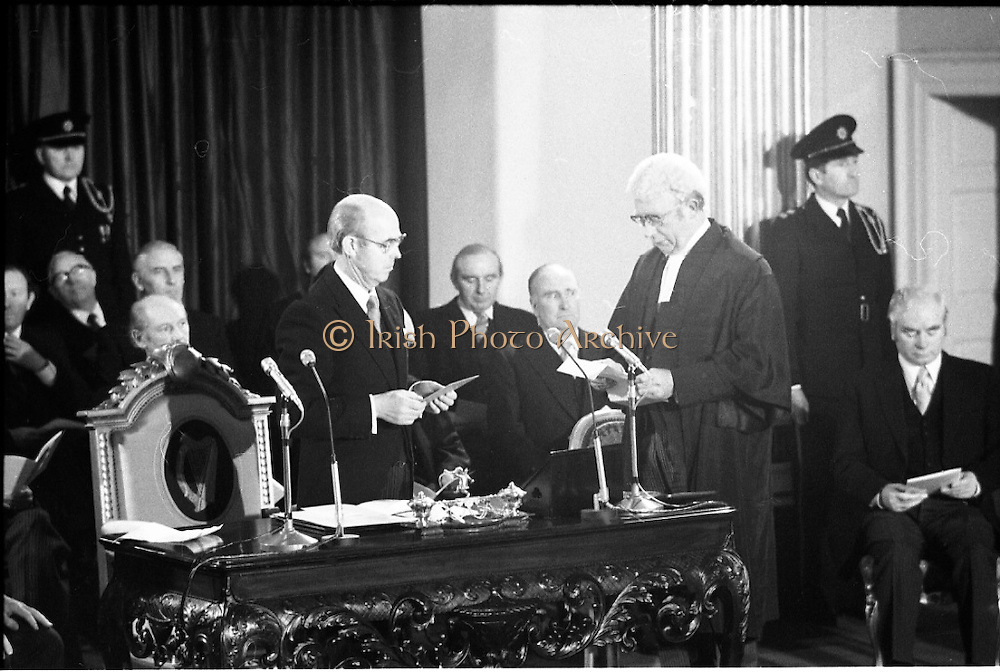 Inaugeration of Cearbhall O'Dalaigh as President  (H77).1974..19.12.1974..12.19.1974..19th December 1974..Following the sudden death of President Erskine Childers, Mr Cearbhall O'Dalaigh was nominated by The Fianna Fail party as its candidate to replace him. The Fine Gael /Labour coalition government did not oppose the nomination and Mr O'Dalaigh was elected un-opposed on a joint party agreement...Image of Mr Cearbhall O'Dalaigh being sworn in as President of Ireland by Chief Justice O'Higgins. Directly behind him is the leader of Fianna Fail,Mr Jack Lynch TD.