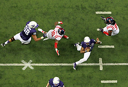 Dec 31, 2014; Atlanta , GA, USA;TCU Horned Frogs quarterback Trevone Boykin (2) runs between Mississippi Rebels defensive end C.J. Johnson (10) and Mississippi Rebels defensive lineman Bryon Bennett (95) during the second quarter in the 2014 Peach Bowl at the Georgia Dome. Mandatory Credit: Kevin Liles/CFA Peach Bowl via USA TODAY Sports
