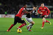 Cardiff city's Kevin Theophile-Catherine (l) is challenged by Adam Lallana of Southampton ®.   Barclays Premier league, Cardiff city v Southampton at the Cardiff city Stadium in Cardiff,  South Wales on Boxing day, Thursday 26th Dec 2013. <br /> pic by Andrew Orchard, Andrew Orchard sports photography.